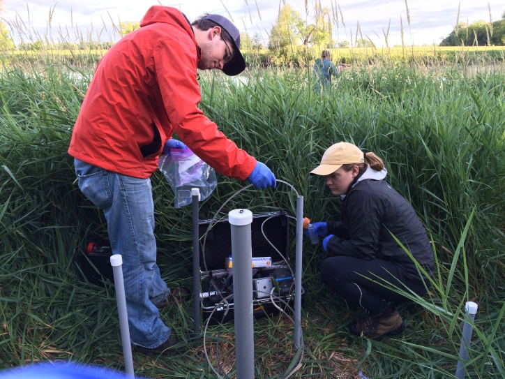 Jake Daire (UMD) and Erin Baumann collect water samples from wells